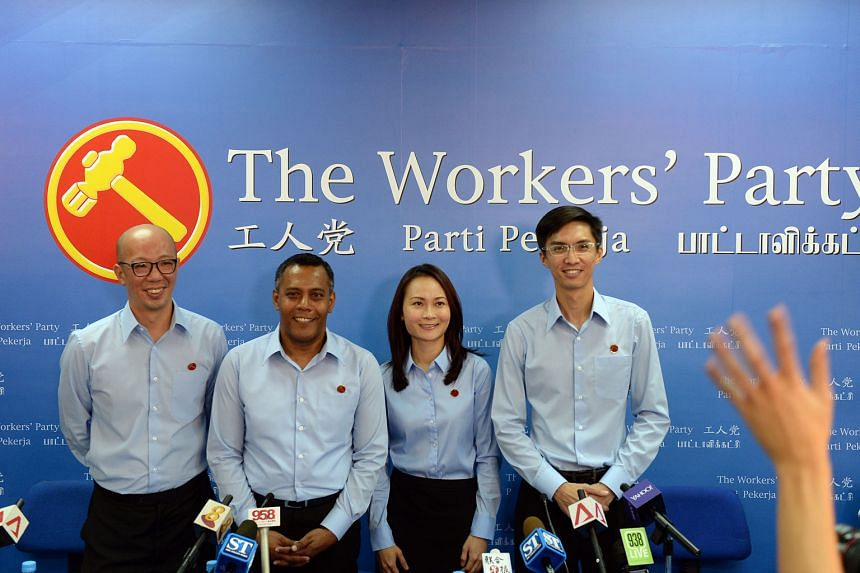 Workers' Party candidates (from left) Terence Tan Li-Chern, Firuz Khan, Cheryl Denise Loh Xiu Wen and Luke Koh Tiong Yee were introduced yesterday. The party has introduced eight candidates so far, leaving another 11 candidates to be formally introdu