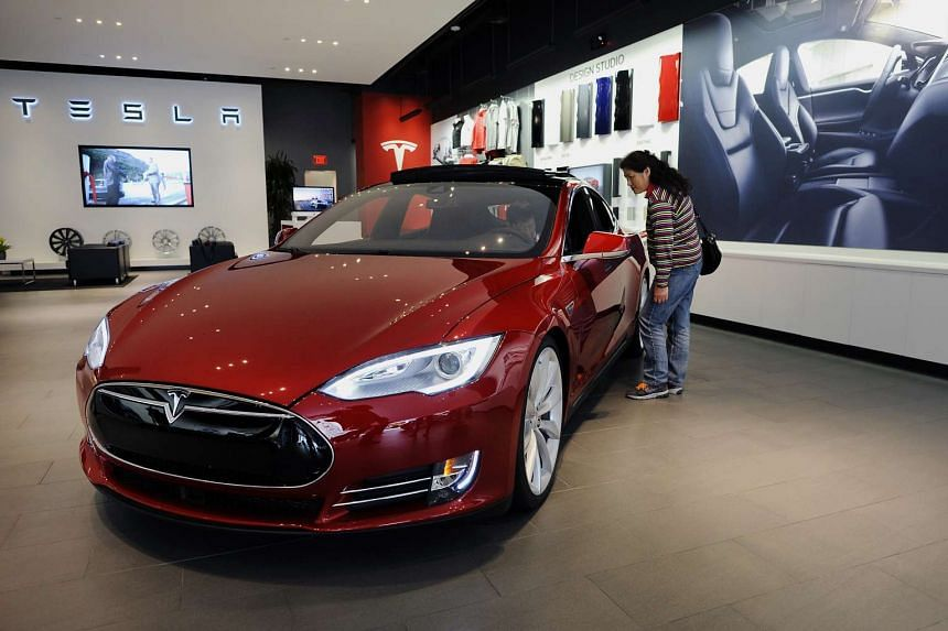 A customer views a Model S P85D electric vehicle at the Tesla Motors retail store in San Jose, California.