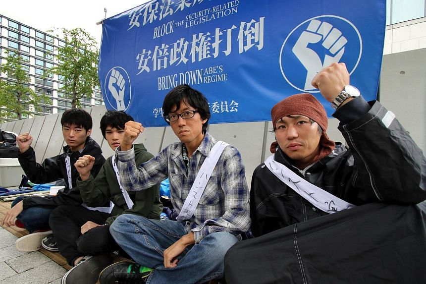 University students stage a hunger strike in front of the National Diet building in Tokyo on Aug 28, 2015.