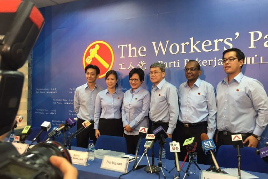 Hougang MP Png Eng Huat (third right) and party chief Sylvia Lim with four candidates introduced on Aug 29, 2015.