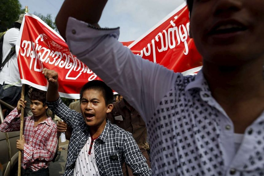 Workers march during a protest to demand for minimum wage in Yangon in this July 12, 2015 file photo.