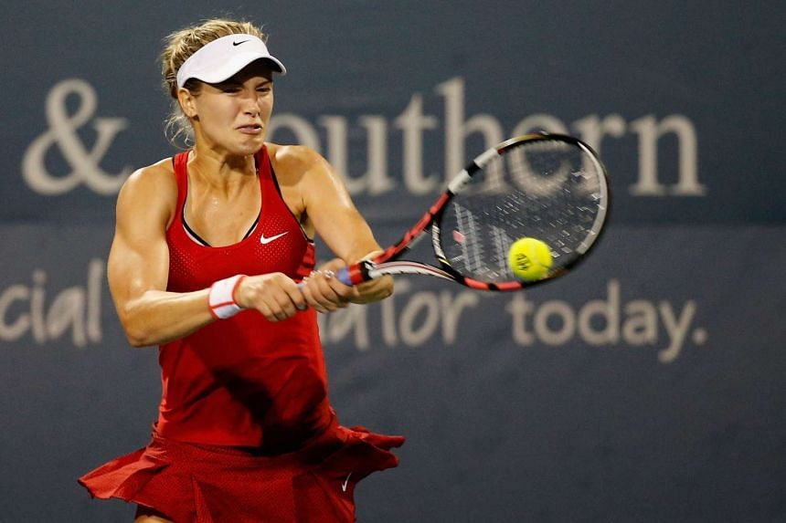 Eugenie Bouchard of Canada returns a shot to Elina Svitolina of Ukraine during the Western & Southern Open at the Linder Family Tennis Center on August 19, 2015 in Cincinnati, Ohio.