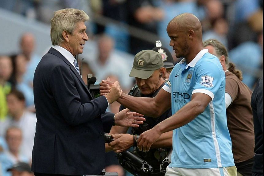 City skipper Vincent Kompany (right), with manager Manuel Pellegrini after a game, put on a brave front following the draw, tweeting that he welcomes the ties against great teams.