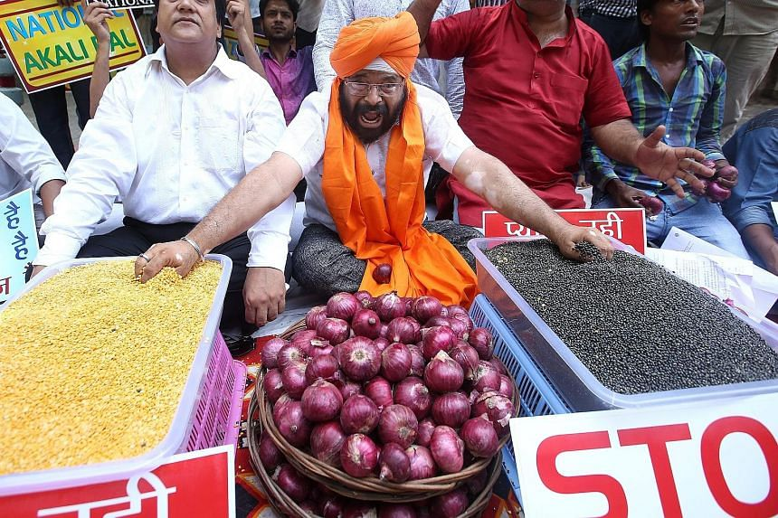An activist with the National Akali Dal party protesting with other activists against the spike in prices of essential foods such as onions and pulses in New Delhi, India. Indian consumers are facing a crisis as the price of onion in many cities has