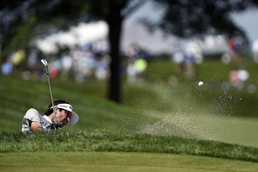 Bubba Watson plays his way out of a bunker at the sixth green during the first round of The Barclays on Thursday. His five-under 65 gives him a four-way share of the lead.