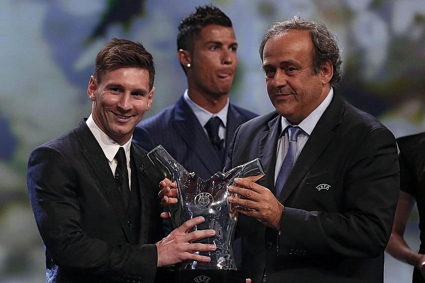 Lionel Messi (far left) receiving the trophy for the best men's player in Europe last season from Uefa president Michel Platini, with rival Cristiano Ronaldo (centre) of Real Madrid coming in second. The Argentinian becomes the first two-time winner
