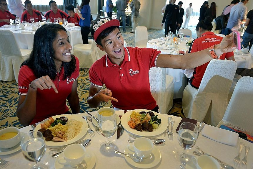 Sprinters Shanti Pereira and Calvin Kang show off their high- performance meals at Swissotel The Stamford before the SEA Games. A well-balanced diet is a vital factor in maximising the performance of runners.
