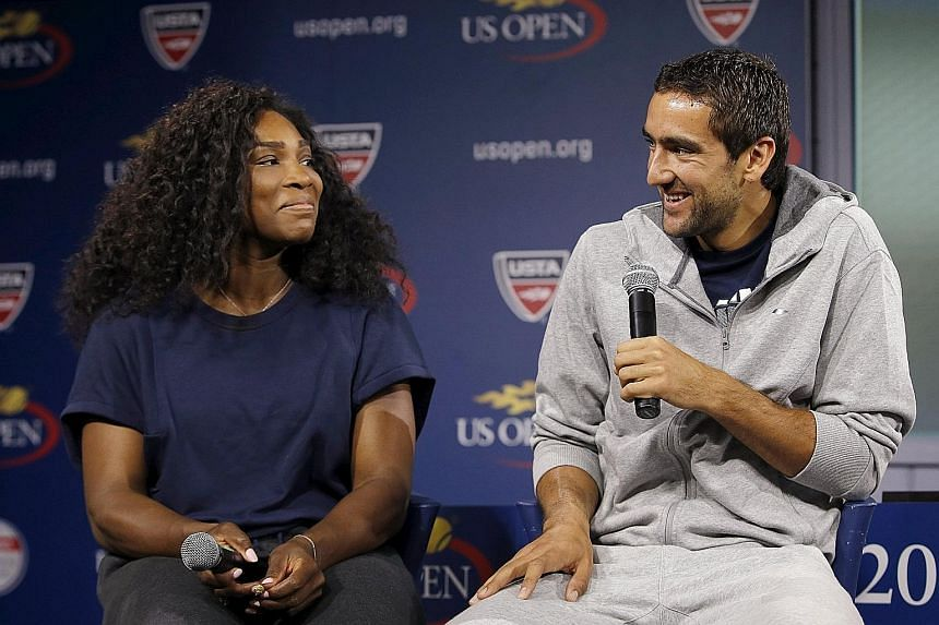 Defending US Open men's and women's singles champions Marin Cilic and Serena Williams at a news conference ahead of the tournament that begins on Monday. If Williams successfully defends her title, she will equal Steffi Graf's Open-era record of 22 G