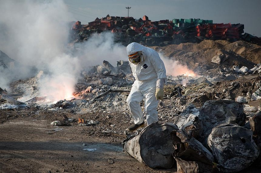 An officer checking for combustible materials at the Tianjin blast site on Thursday. The disaster on Aug 12 has left 89 firefighters, nine policemen and 48 others dead, and the death toll is expected to rise.