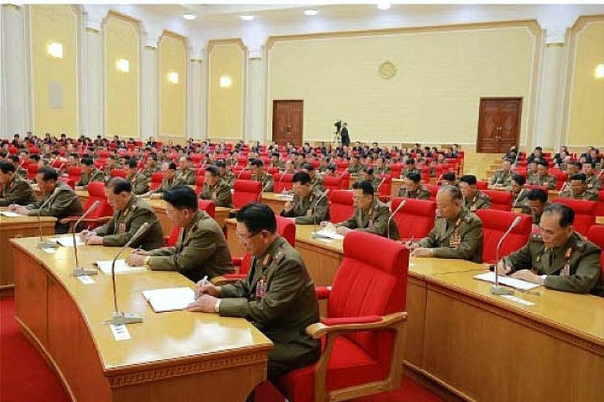 Undated pictures released by the Rodong Sinmun, the newspaper of the ruling North Korean Workers Party, yesterday show Mr Kim Jong Un (above) and a meeting of the Central Military Commission (right).