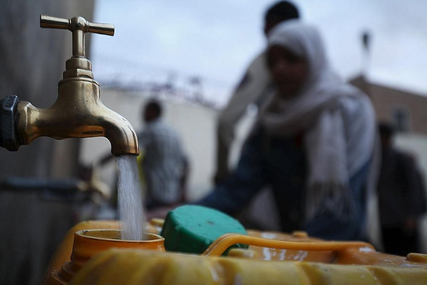 A girl filling a jerrycan with water from a public tap during a water shortage in Sanaa, Yemen, in June. A World Resources Institute report says the world's demand for water is expected to surge in the next few decades and places such as Singapore an