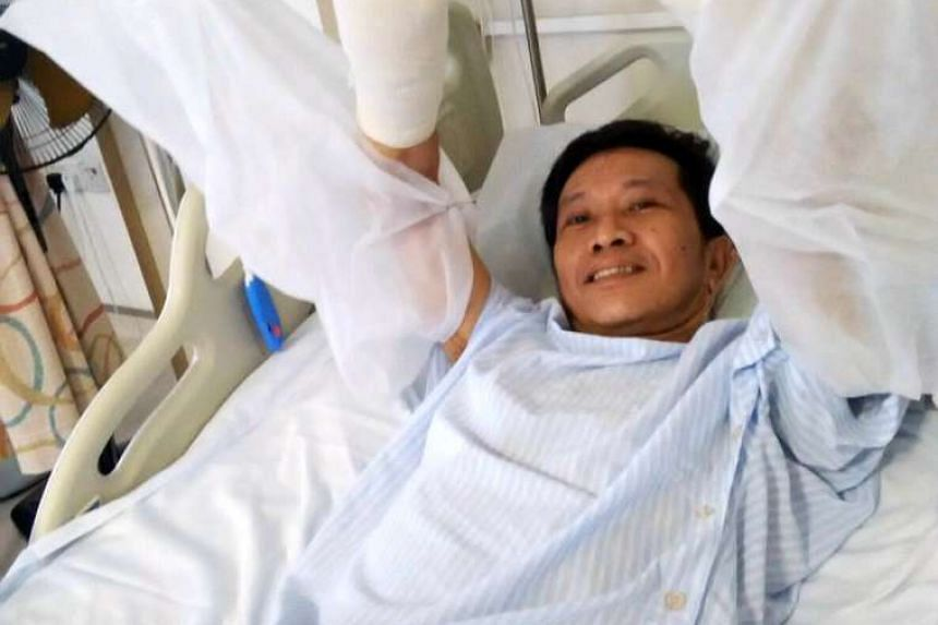 Technician Tan Whee Boon, whose were hands amputated at the wrist on August 21, had his feet amputated on Thursday.