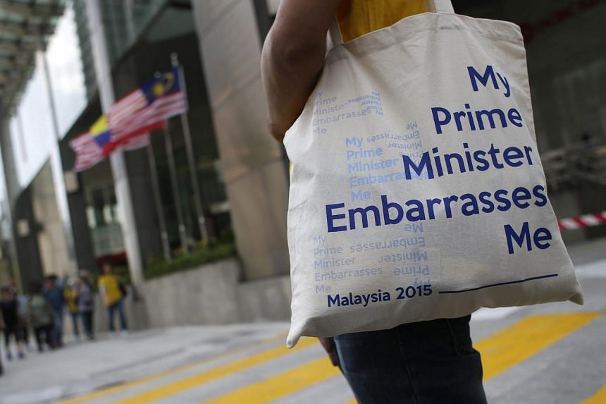 A Malaysian protestor carries a bag reading 'My Prime Minister Embarrasses Me' during a Bersih rally in Kuala Lumpur, Malaysia on Aug 29, 2015.