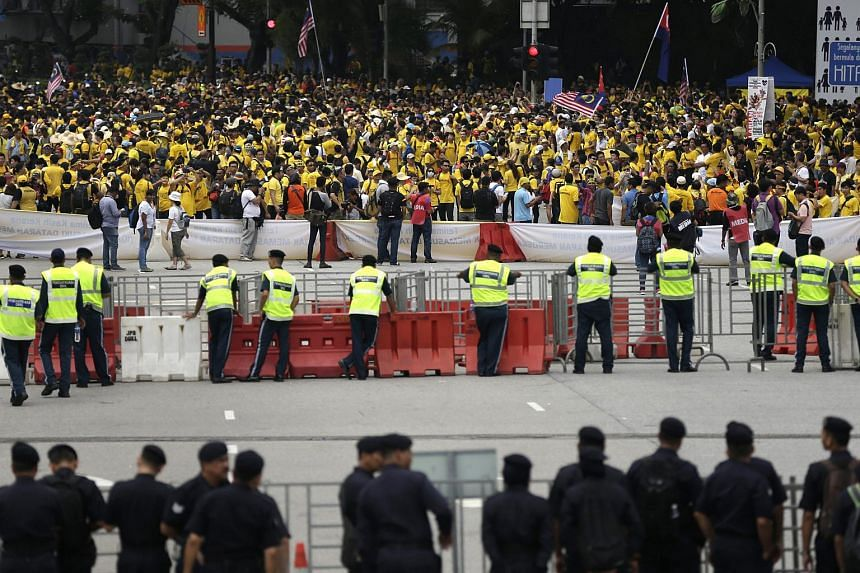 Malaysian police man a road block as thousands of protestors marched but were stopped on the other side during the Bersih rally in Kuala Lumpur, Malaysia on Aug 29, 2015.