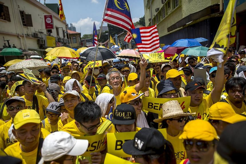 Supporters of pro-democracy group Bersih gather near Chinatown in Malaysia's capital city of Kuala Lumpur on Aug 29, 2015.