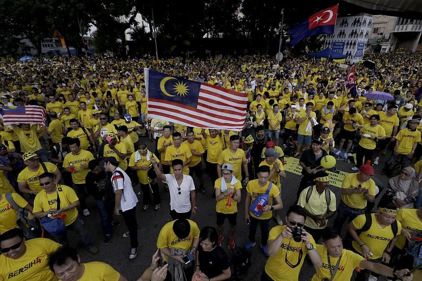 Thousands of Malaysian protestors march through the city streets while waving the national flag during a Bersih rally in Kuala Lumpur, Malaysia on Aug 29, 2015.