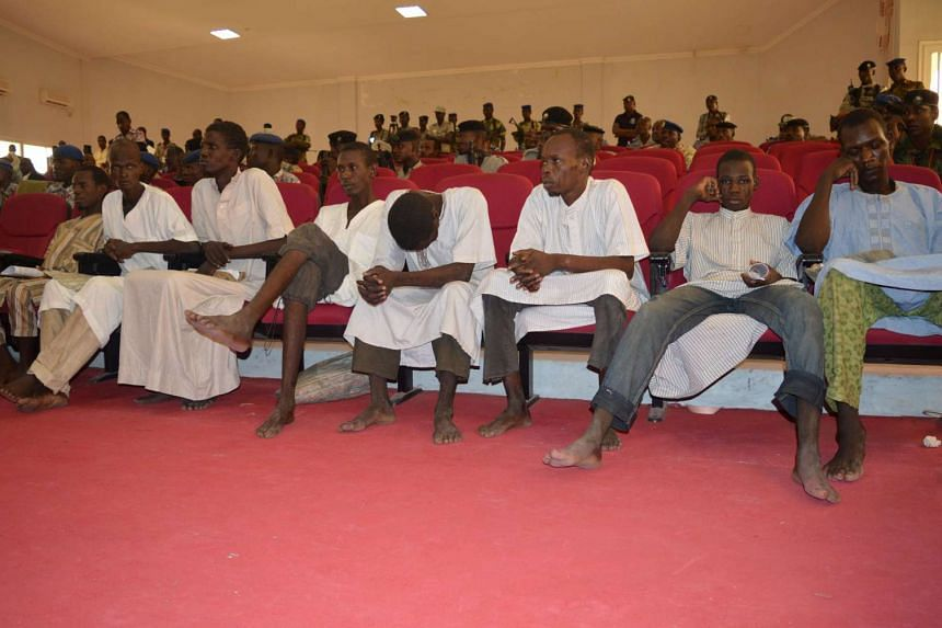 Men accused of being members of insurgent group Boko Haram attend their trial in Chad, Aug 26, 2015.