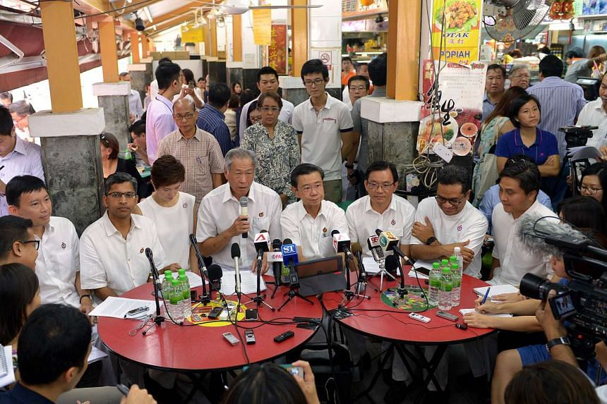 The People's Action Party introducing its first batch of new candidates for the Bishan-Toa Payoh GRC at the coffee shop at block 178 Toa Payoh Central on Aug 12, 2015