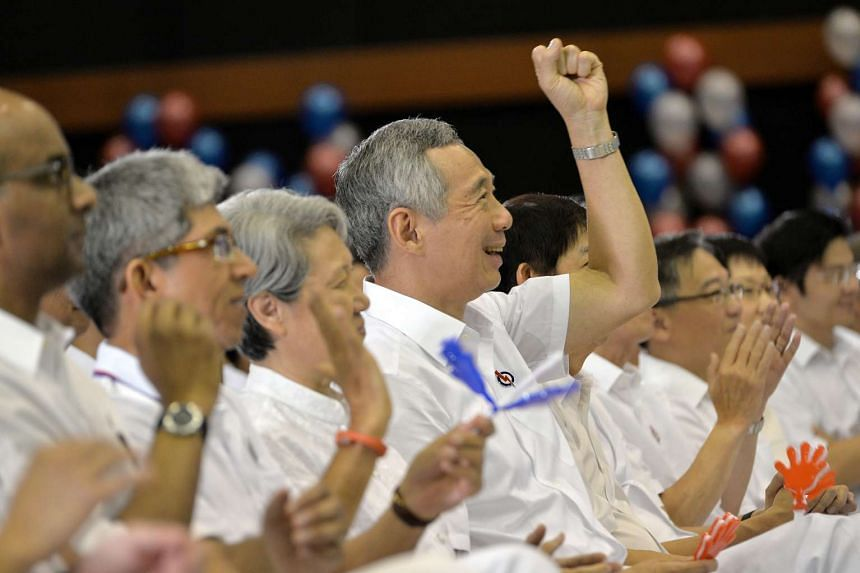 Prime Minister Lee Hsien Loong (centre), his wife Ho Ching and PAP MPs at the launch of the party's manifesto.
