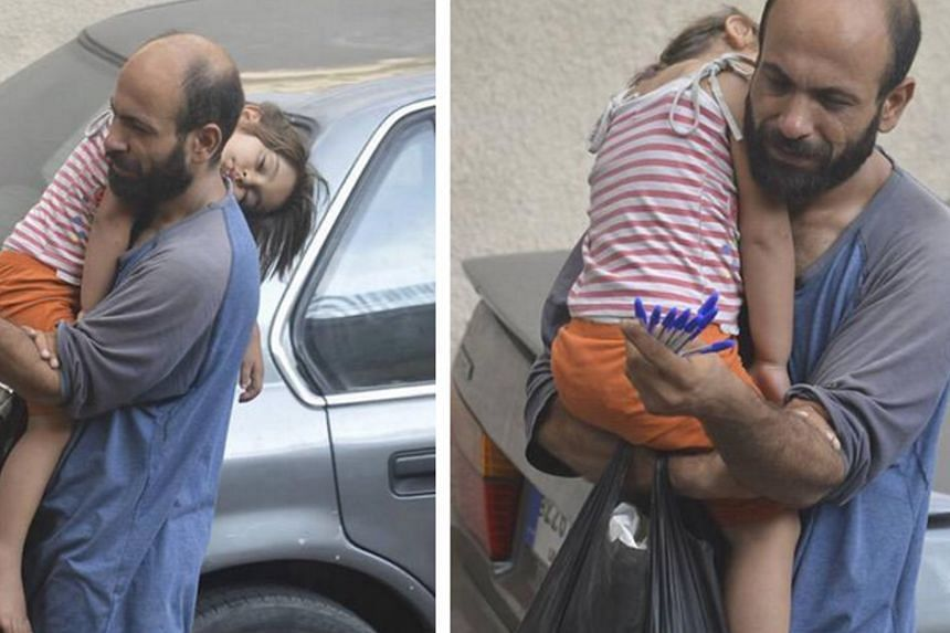 The photos that went viral of Abdul selling pens with four-year-old daughter sleeping on his shoulder.