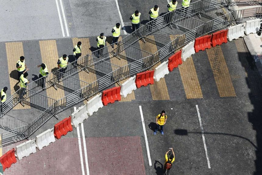 Protesters taking photos in front of police barricades ahead of the Bersih-led rally in Kuala Lumpur on Aug 29, 2015.