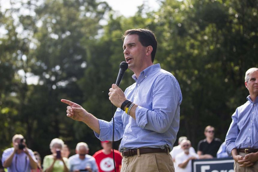 Wisconsin governor and US presidential candidate Scott Walker speaks to voters at the Prince William County Young Republicans' Grillfest at the Republican Committee Headquarters in Woodbridge, Virginia USA on Aug 29, 2015.