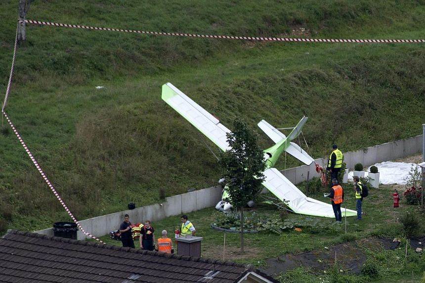 A small plane on the ground at the scene of a crash in Dittingen, Switzerland, on Aug 23, 2015.
