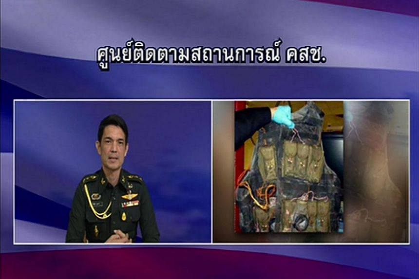 This television frame grab taken on Aug 29, 2015 from Thai television station Channel 3 shows a NCPO broadcast with an inset picture of a suicide vest (right).