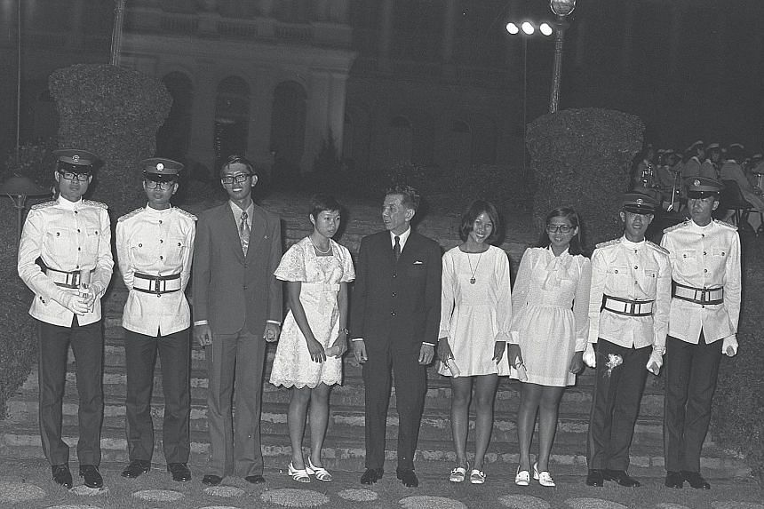 Eight of 11 President's Scholars from the class of 1972 are seen here with then President Benjamin Sheares (centre) at the Istana. They are (from left) Lim Hng Kiang, Lim Teik Hock, Chan Seng Onn, Lee Wei Ling, Lee Bee Wah, Yap Hui Kim, George Yeo an