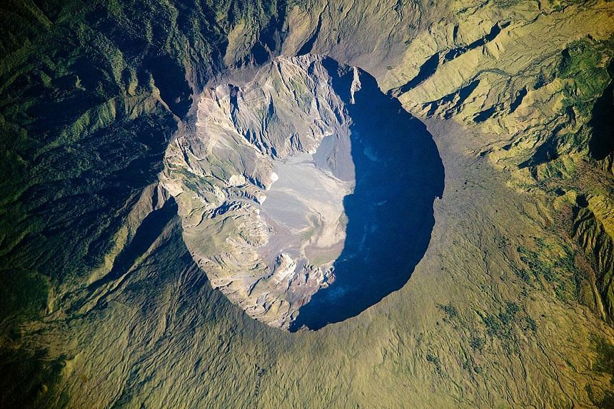 A Nasa photo depicting the summit caldera of the Tambora volcano in Indonesia. In April 1815, Tambora erupted in the most powerful volcanic blast in recorded history, shaking the planet in a catastrophe so vast that, 200 years later, investigators ar