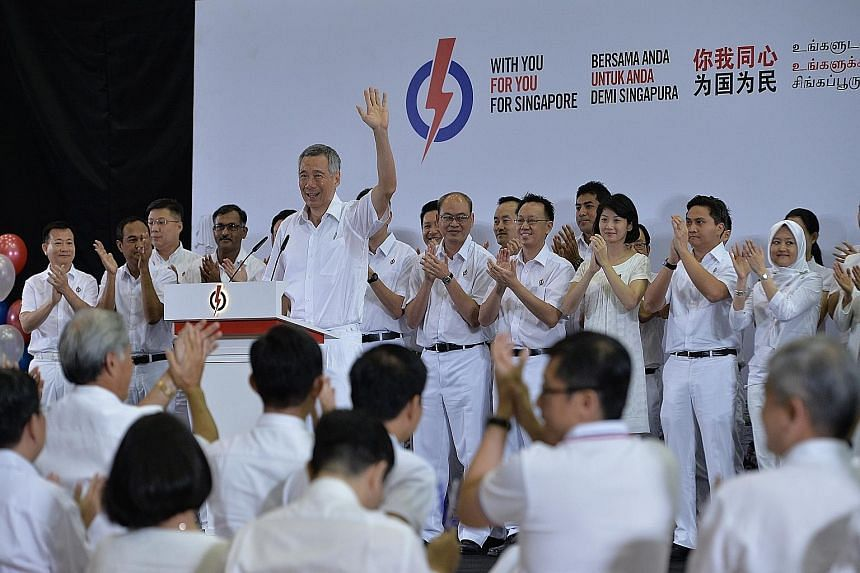Above: Party members applauding yesterday after PM Lee introduced all the new PAP candidates. Right: PM Lee introducing former defence force chief Ng Chee Meng as a new member of the PAP. Ms Tin Pei Ling, who gave birth just three weeks ago, said she