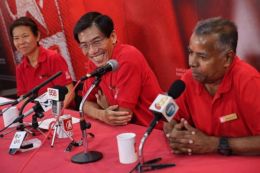 Singapore Democratic Party's secretary-general Chee Soon Juan (centre) introducing candidates Wong Souk Yee and Sadasivam Veriyah yesterday. Mr Chee also formally announced that he will be contesting the coming general election.