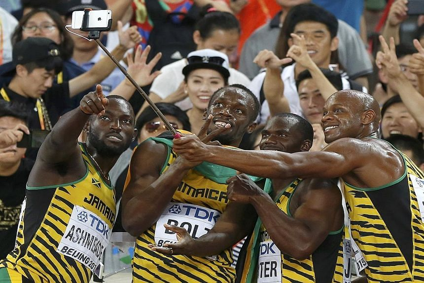 """Members of the victorious Jamaican 4x100m relay team (from left) Nickel Ashmeade, Usain Bolt, Nesta Carter and Asafa Powell pose for """"wefies"""" after winning in 37.36sec, giving Bolt his 11th gold medal at a major competition. The US were disqualified,"""
