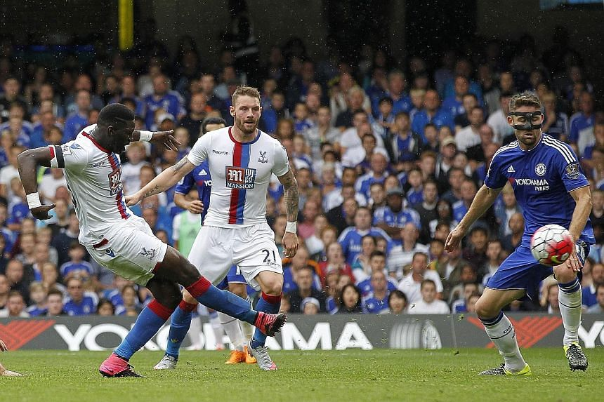 Crystal Palace's French midfielder Bakary Sako (left) scores his team's first goal during the shock 2-1 win against Chelsea at Stamford Bridge yesterday. The Blues' paltry total of four points from four games represents their worst start to a season