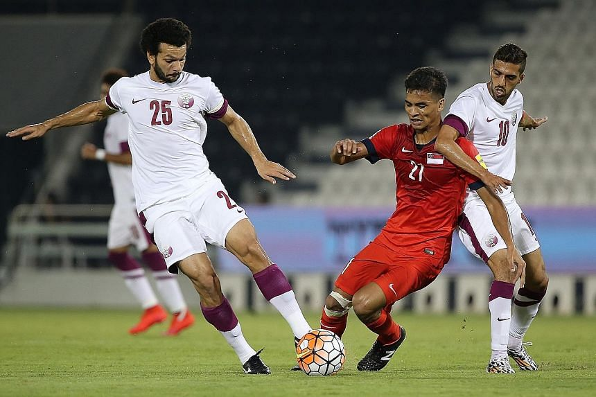 The Lions, with Safuwan Baharudin (centre) in the thick of action, went down 0-4 to Qatar in a friendly match in Doha, ahead of their World Cup qualifier against Syria.