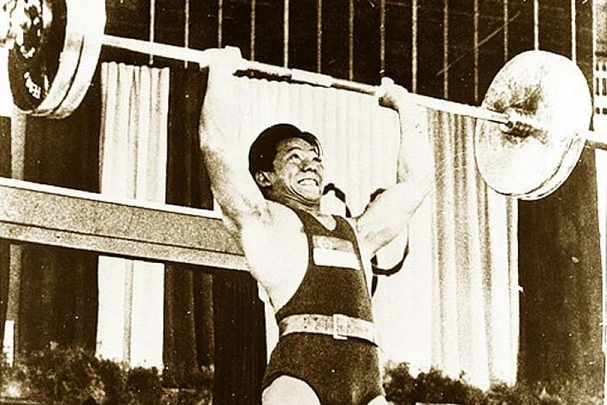 Tan Howe Liang winning the weightlifting silver medal at the Rome Olympics. He lifted more than 380kg in total, becoming Singapore's first Olympic medallist.