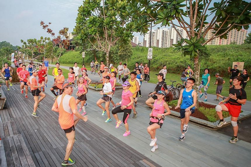 Participants in the 18.45km category of the ST Run at the Hub warming up before their second training session yesterday at the Punggol Promenade. Led by the event's official pacers from local running group Team FatBird, they ran about 12km along the