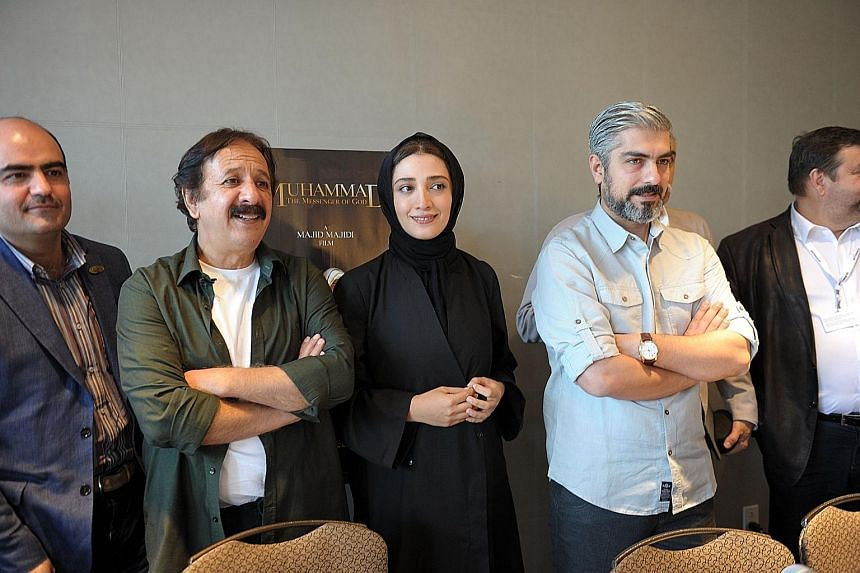Director Majid Majidi (in white T and olive green shirt) with the crew of the Iranian movie Mohammad, Messenger Of God at its world premiere during the Montreal Film Festival last Thursday.
