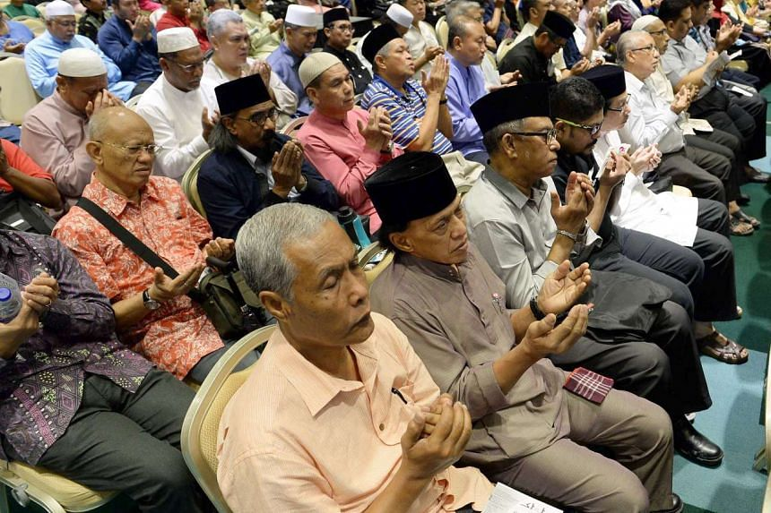 Pilgrims and guests at the pre-departure haj briefing organised by the Association of Muslim Travel Agents Singapore (AMTAS) with support from Muis, held at the Singapore Expo on 2 August 2015.
