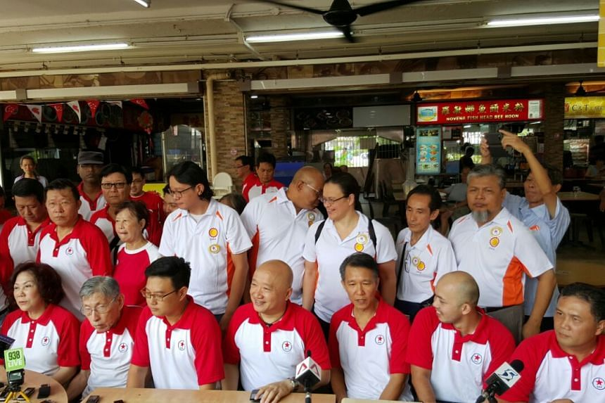 (Seated, from left) Mrs Lina Chiam and Mr Chiam See Tong with the joint DPP-SPP team contesting Bishan-Toa Payoh GRC, consisting of Mr Bryan Long, Mr Benjamin Pwee, Mr Law Kim Hwee, Mr Abdillah Zamzuri and Mr Hamim Aliyas.