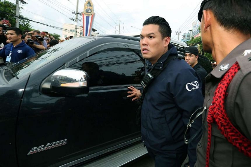 Thai police officers surrounding a car believed to be carrying a suspect arrested in connection with the Bangkok bombing, on the outskirts of Bangkok on Aug 29, 2015.