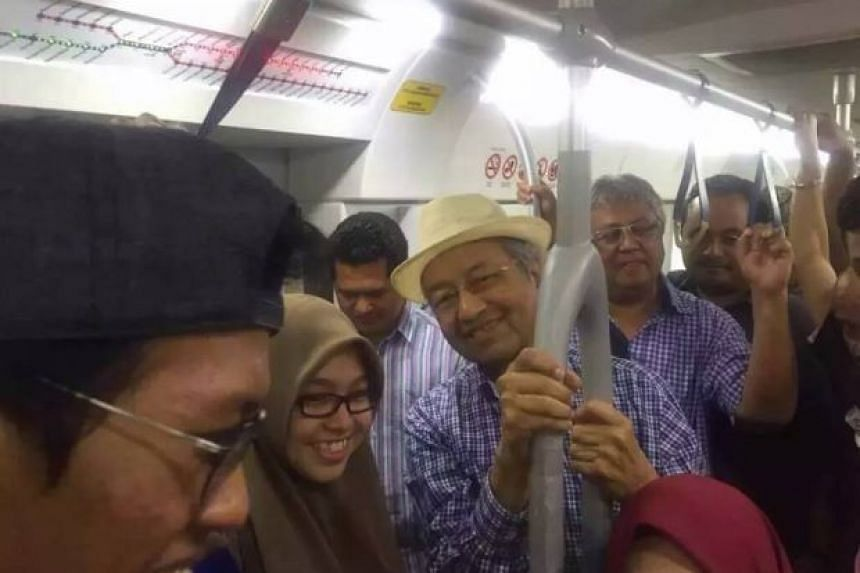 Former Malaysian prime minister Mahathir Mohamad riding the train together with former Umno minister Zaid Ibrahim (behind Dr Mahathir) on the way to a Bersih rally on Aug 30, 2015.