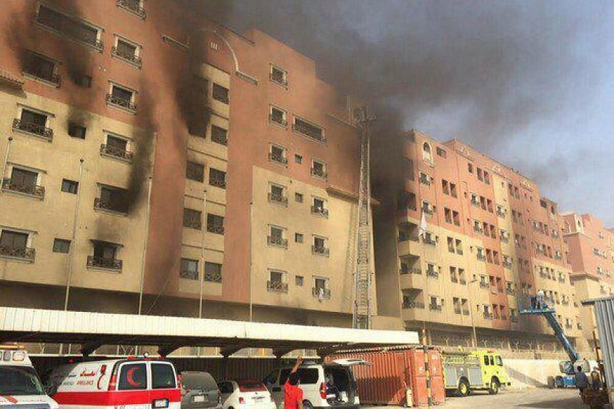 Smoke rising from a fire in a block of apartments that killed at least six people and injured more than 200 others, in Khobar, Saudi Arabia, on Aug 30, 2015.