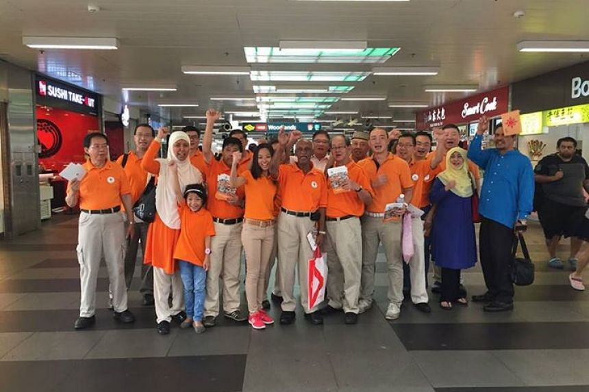 Members of the National Solidarity Party posing at Woodlands MRT station during a walkabout in the Woodlands and Sembawang areas on Sunday morning.