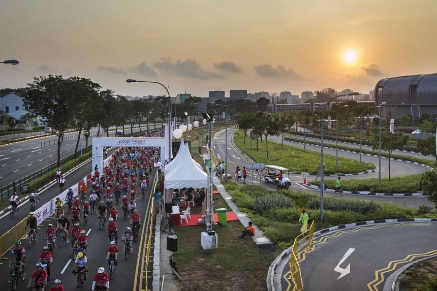 Flag-off at sunrise for participants of the inaugural The Straits Times Ride.