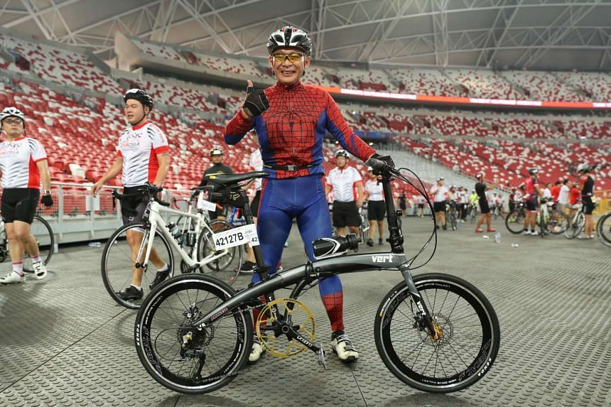 Stanley Neo, 51, dressed as Spider-Man as he took part in The Straits Times ride.