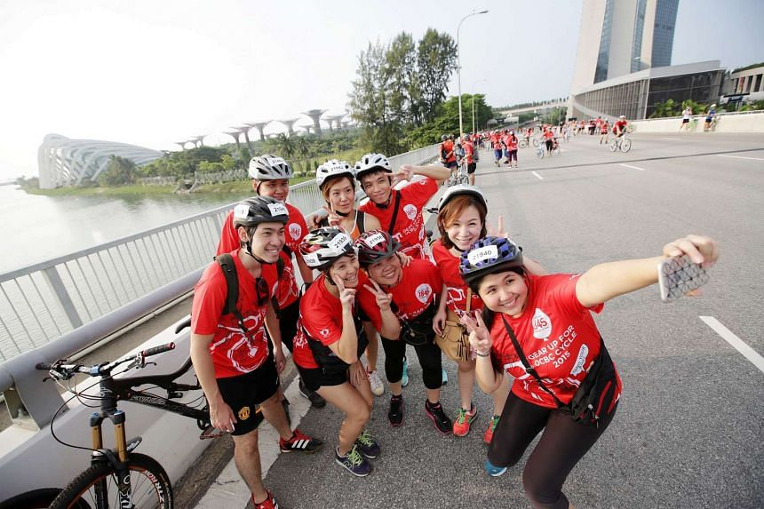Participants of The Straits Times Ride taking a selfie on the Benjamin Sheares Bridge.