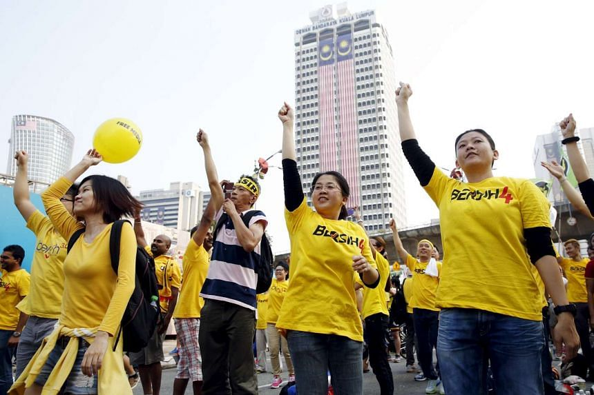 Protesters exercise during a rally organised by pro-democracy group Bersih (Clean) in Malaysia's capital city of Kuala Lumpur, on Aug 30, 2015.