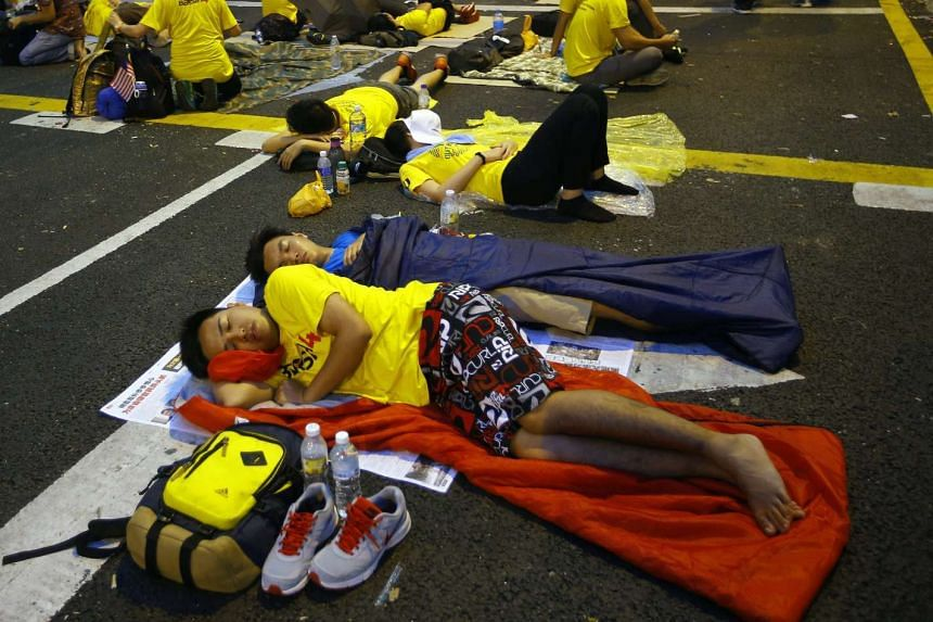 Malaysian protestors sleep on the street during a Bersih (The Coalition for Free and Fair Elections) rally in Kuala Lumpur, Malaysia, on Aug 30, 2015.