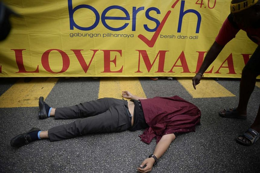 Rally attendees rest during the Bersih 4.0 rally at Merdeka Square on Aug 29, 2015.